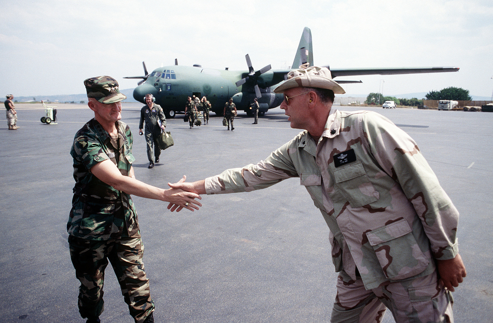 LGEN Daniel Schroeder, U.S. Army, Commander Joint Task Force (JTF) is greeted by LCOL Ron Peck, Commander, 21st Air Mobility Operations Group (AMOG) Dover AFB, Denver, upon his arrival at Kigali Airport to check on status of the relief operation