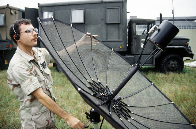 Weather forecaster, TSGT Michael Willen, 438th Operations Support Squadron/Operations Support Wing, McGuire AFB, New Jersey checks the lineup of the satellite that allows him to receive weather reports for the aircrews that transit Entebbe in support of the humanitarian relief effort