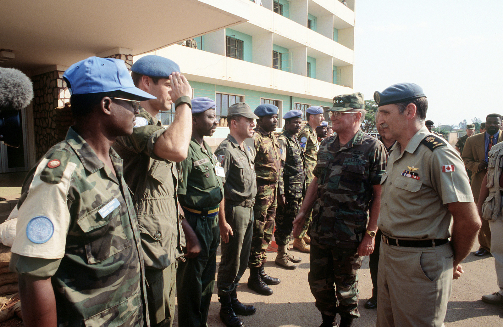 Army GEN John M. Shalikashvili, Chairman of the Joint Chiefs of STAFF inspects United Nations troops from Ghana's Fighting Third during a visit to check the progress of the Rwandan relief effort