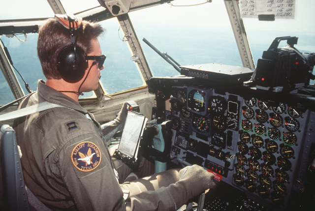 CAPT. Rick Ford, a pilot with the 136th Airlift Wing 181st Airlift Squadron, Dallas, Texas Air National Guard, flies a C-130 Hercules aircraft loaded with supplies to Entebbe, Uganda