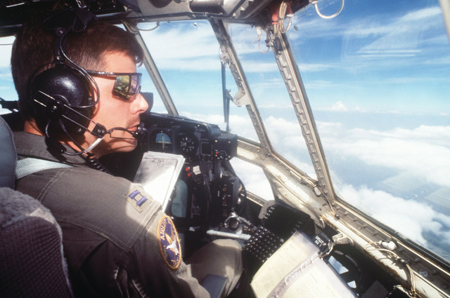 CAPT. Rick Ford, a pilot with the 136th Airlift Wing 181st Airlift Squadron, Dallas, Texas Air National Guard in the cockpit of a C-130