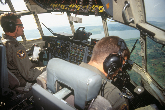Capts. Rick Ford and John Gustafson, pilots with the 136th Airlift Wing 181st Airlift Squadron, Dallas, Texas Air National Guard, flies a C-130 Hercules aircraft loaded with supplies to Entebbe, Uganda