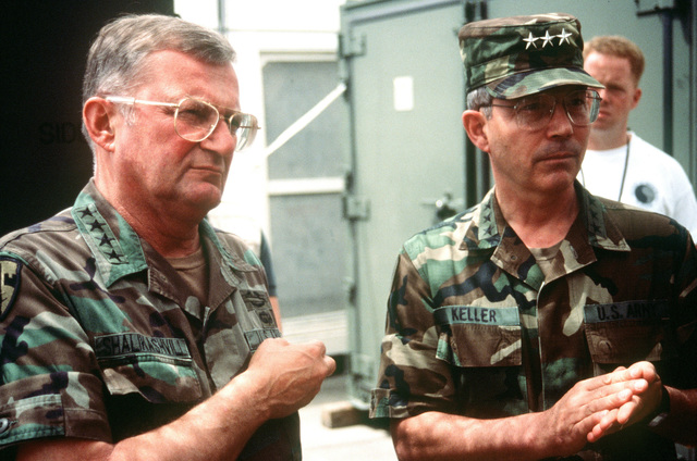 GEN. John M. Shalikashvili, chairman of the Joint Chiefs of STAFF, is briefed by LT. GEN. Richard F. Keller, CHIEF of STAFF US European Command, about the mission at Moi International Airport. (Duplicate image, see also DFST9905506)