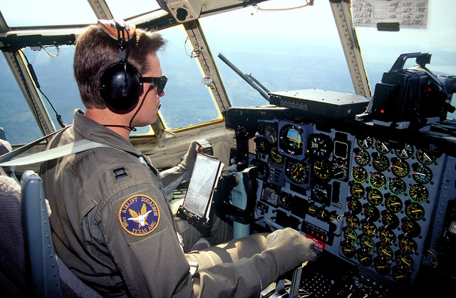 Pilot CPT Rick Ford at his crew position on the C-130 Hercules assigned to the 136th Airlift Wing, 181st Airlift Squadron, Dallas, Texas ANG in route with relief supplies from Moi International Airport to Entebbe, Uganda