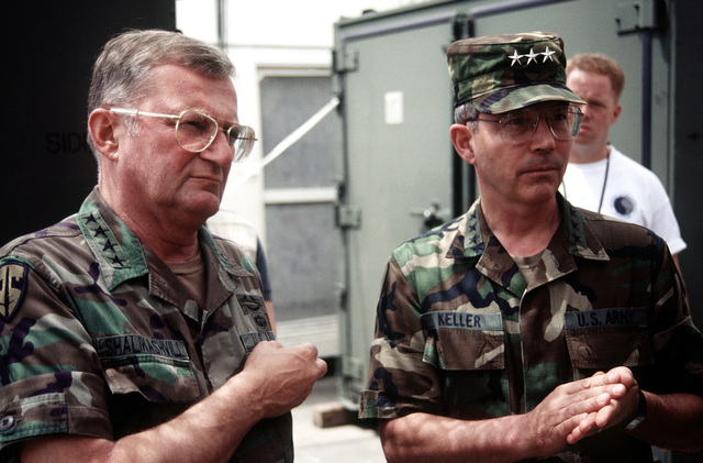 GEN John M. Shalikashvili, Chairman of the Joint Chiefs of STAFF, discusses the status of the humanitarian airlift missions into Goma, Zaire with Army LGEN Keller. (Duplicate image, see also DFST9801696)