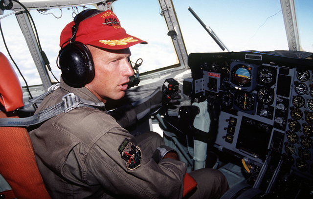 Marine KC-130R pilot MAJ Rick Snyder, VMGR 252 (Otis) Cherry Point, North Carolina at his position in route from Mombasa to Kigali Airport in Kenya