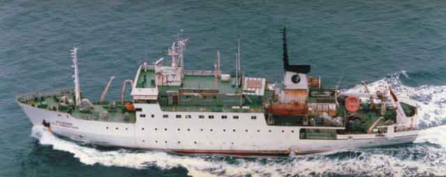 ......An aerial port side view of the Russian Akademik Boris Petrov class research ship AKADEMIK M. A. LAVRENTYEV underway in the Western Pacific area. Note the difference between the starboard (next view) and port views making it appear to be two separate vessels
