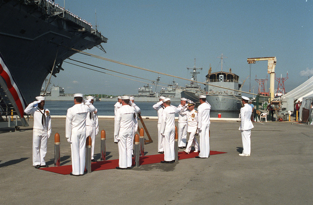 Admiral Jeremy M. Boorda, CHIEF of Naval Operations, is piped aboard for the decommissioning ceremony of the aircraft carrier USS SARATOGA (CV-60) at Naval Station Mayport. The SARATOGA, first commissioned on 14 April 1956 at the old New York Naval Shipyard, is being decommissioned after more than 38 years of service