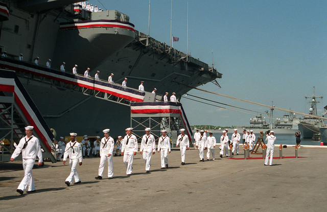 Ranks of enlisted crew members of the aircraft carrier USS SARATOGA (CV-60) file off the ship for the last time at the end of the decommissioning ceremony. The SARATOGA first commissioned at the old New York Naval Shipyard on 14 April 1956 at an attack aircraft carrier (CVA-60) of the Forrestal class