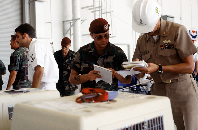 LT. j.g. Rick Rodriqauez, Office in Charge, Naval Construction Battalion 411 (NCB-411) Naval Base Norfolk, verifies names of the pet animals that have just arrived from Naval Base Guantanamo Bay, Cuba during Operation Sincere Welcome. Dependents and excess personnel are being air-lifted out of Cuba to make room for the large number of Cuban refugees