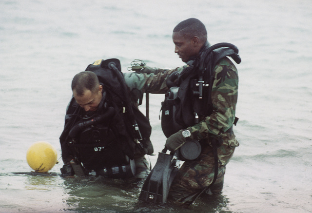 STAFF SGT. Martinez (left) and STAFF SGT. Long enter the waters at Fleming Key preparing for a dive. Both men are U.S. Marine Corps active duty training (ACDUTRA) reservists and are from the 3rd Force Reconnaissance Company in Mobile Alabama