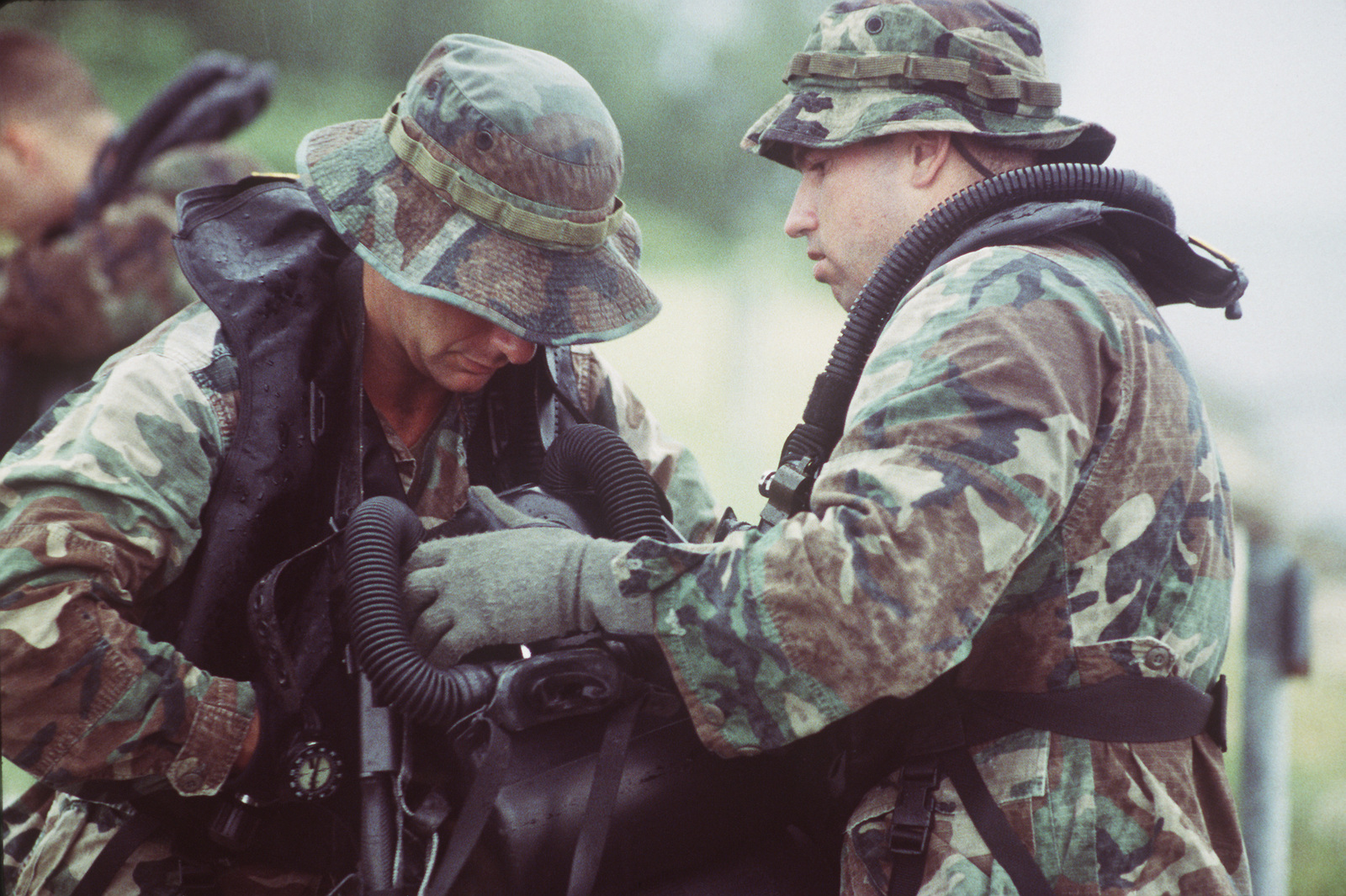 STAFF SGT. Stockwell (left) and CAPT. D Amico suit up using