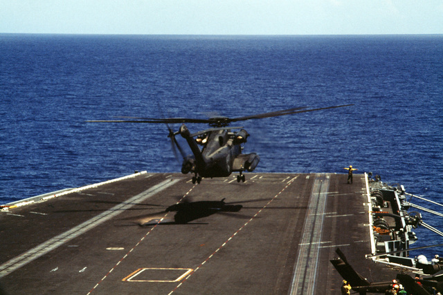 A US Navy CH-53 Super Stallion helicopter participates in flight operations on board the aircraft carrier during the air assault rehearsal