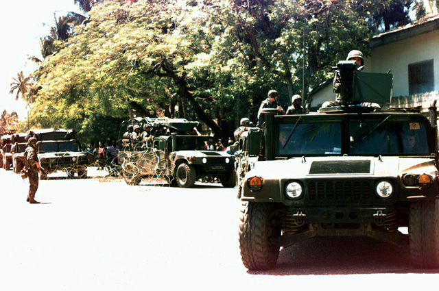 A special purpose Marine Air-Ground Task Force (MAGTF) convoy rolls through the streets of Cap Haitien during Operation Uphold Democracy