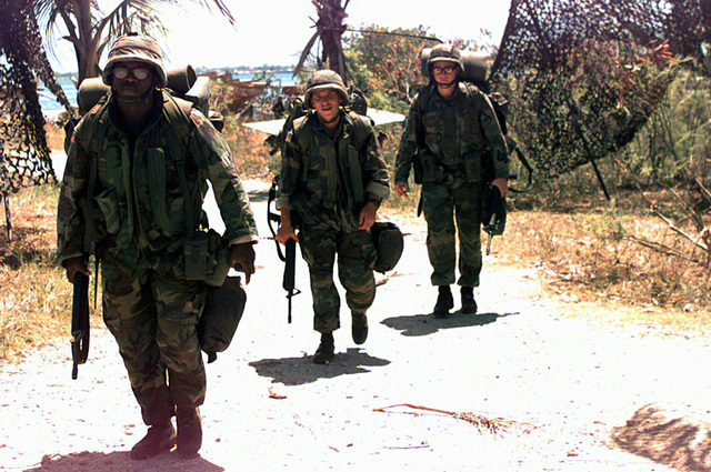 Marines from the special purpose Marine Air-Ground Task Force (MAGTF) patrol the port of Cap Haitien during Operation Uphold Democracy