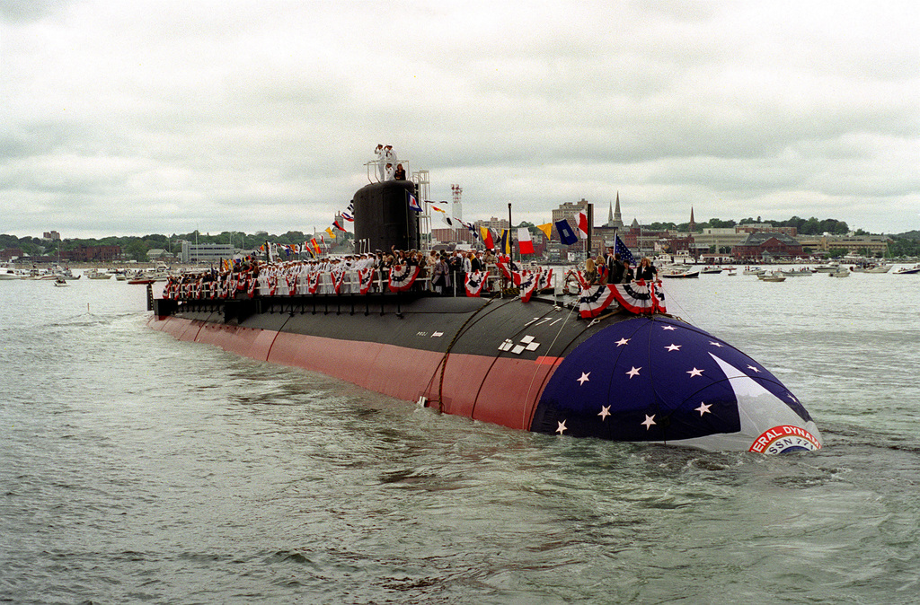 A starboard bow view of the nuclear-powered attack submarine COLUMBIA (SSN-771) as the ship glides to a stop in the Thames River at the completion of the vessel's christening and launch ceremony. The COLUMBIA is the last Los Angeles class submarine to be built at the Electric Boat Shipyard