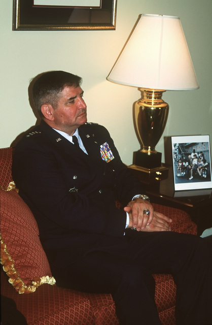 Air Force CHIEF of STAFF, General Ronald Fogelman sits in the living room of the new Fisher House during the press conference and dedication ceremony. The house was built by Zachary and Elizabeth Fisher for terminally ill service members and their dependents and is the 18th Fisher House