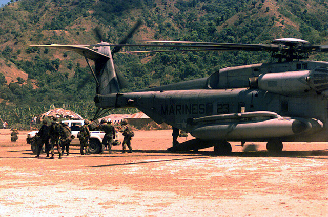 Marines load seized weapons into a CH-53 helicopter. The weapons were confiscated in the Haitian town of Grande Riviere Du Nord during Operation Uphold Democracy