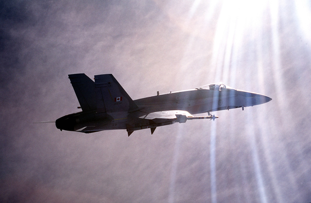 A right side view of a CF-18 fighter aircraft from the 3rd Fighter Wing, Canadian Air Force, flies an air-to-air missile sortie during competition.(Exact date unknown)