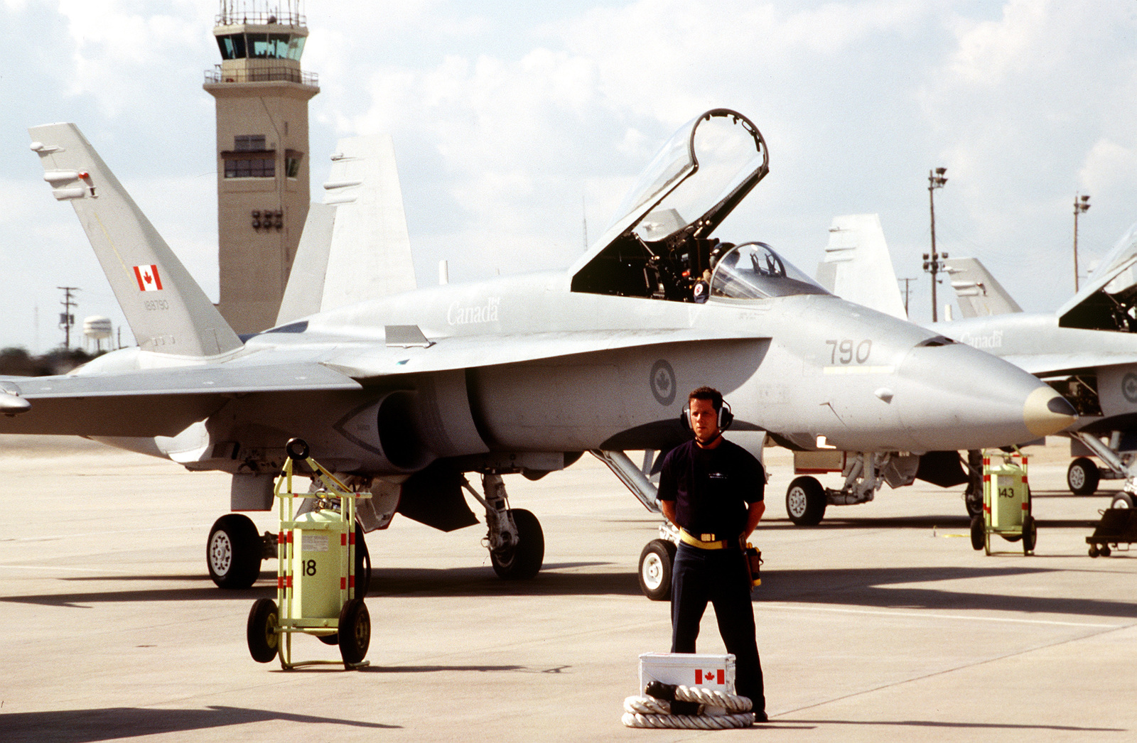 CPL. Pierre Brisson, a crew chief from the 3rd Fighter Wing, Canadian Air Force, awaits the departure of his CF-18 fighter aircraft for a mission profile sortie during the competition