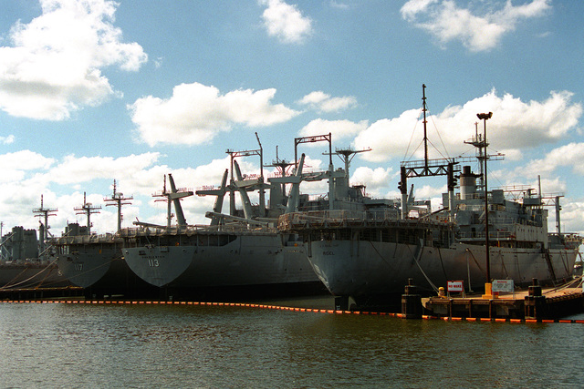 A view of a portion of the mothball fleet in storage near Portsmouth. From right to left are the store ship RIGEL (AF-58) the amphibious cargo ships CHARLESTON (LKA-113) and EL PASO (LKA-117) and four Newport class tank landing ships