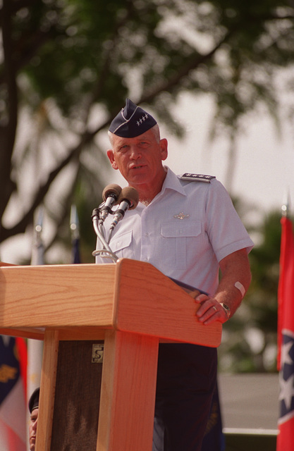 A Close up view of Adm. Richard Macke, United States Commander and CHIEF of Pacific Air Command (USCINCPAC), as he stands at the podium to address attendees at the Pacific Air Forces Change of Command ceremony. General Robert L. Rutherford relinquished command to GEN. John G. Lorber