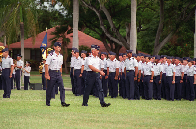 GEN. Robert L. Rutherford inspects the 15 Air Base Wing personnel during the Pacific Air Forces Change of Command ceremony
