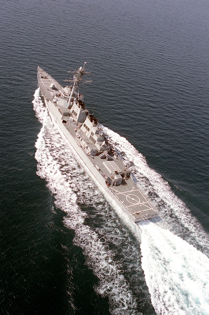 Oblique aerial port quarter view of the guided missile destroyer USS BARRY (DDG-52) underway at high speed as part of the GEORGE WASHINGTON (CVN-73) Battle Group