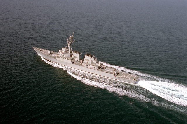 Oblique aerial port side view of the guided missile destroyer USS BARRY (DDG-52) underway at high speed as part of the GEORGE WASHINGTON (CVN-73) Battle Group