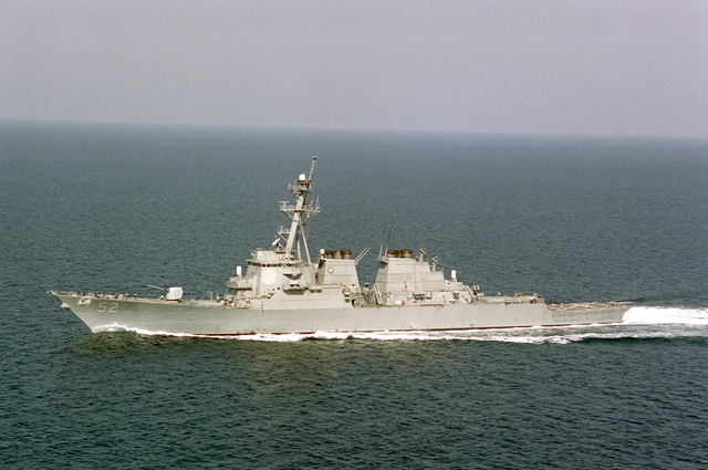 Port bow view (horizontal format) of the guided missile destroyer USS BARRY (DDG-52) underway off the stern quarter of the USS GEORGE WASHINGTON (CVN-73) (not shown). The warships are responding to Iraq's massing troops along the Kuwaiti border