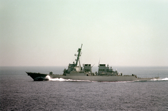 Port side view of the guided missile destroyer USS BARRY (DDG-52) underway as part of the GEORGE WASHINGTON (CVN-73) Battle Group