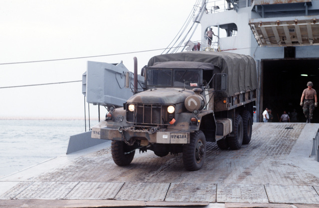 A US Army M939A2 5 ton truck rolls down the ramp of the Ready Reserve Force ship CAPE DECISION (T-AKR-5054) at a port facility in the Arabian Gulf region on 19 Oct 1994. Army stevedores from the 567th Transportation Unit, Ft Eustis, Va. were flown to the region to download the equipment from the ships in preparation for Operation VIGILANT WARRIOR, the US Armed Forces response to aggressive Iraqi actions towards Kuwait