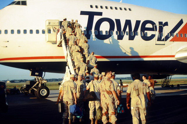 Members of a US Central Command team, from the MacDill AFB, Fla. deployment team load a commercial aircraft before deploying to Southwest Asia (SWA)