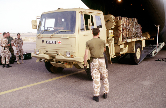 A truck is driven off a British C-130 at Kuwait International Airport. The British troops joined the United States forces in response to Saddam Hussein's advancement to the Kuwaiti border