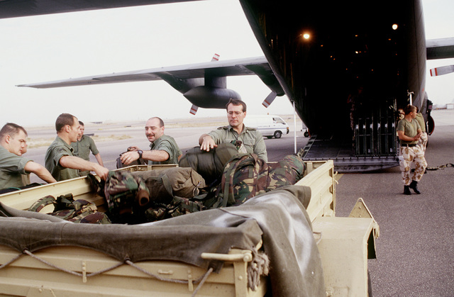 British personnel off-load equipment from a British C-130 at Kuwait International Airport. The British troops joined the United States forces in response to Saddam Hussein's advancement to the Kuwaiti border