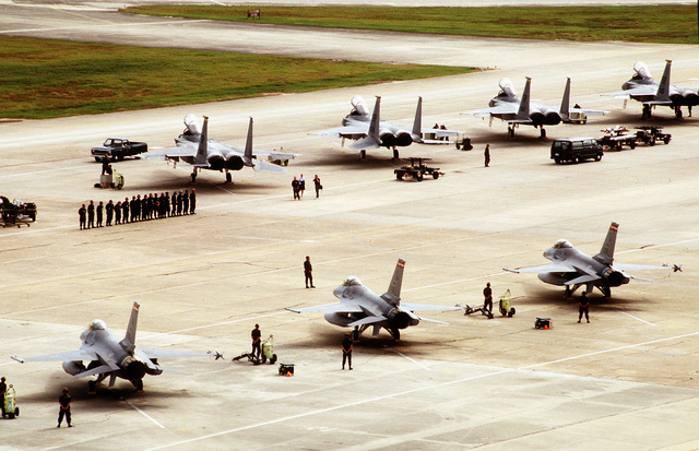 F-16 Fighter aircraft from the 119th Fighter Group, North Dakota, Air National Guard, and F-15 Fighter Aircraft from the 52nd Fighter Wing, Spangdahlem Air Base, Germany, sit on the flightline during competition William Tell '94
