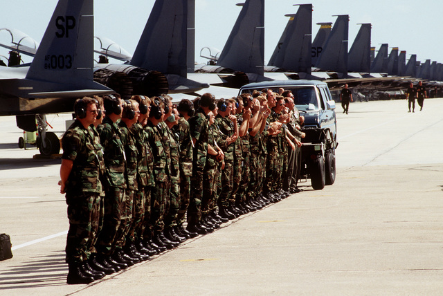 Maintenance personnel from the 119th Fighter Group, North Dakota Air National Guard, line up to watch their F-16 Fighter aircraft depart for a Profile #3 mission during competition William Tell '94