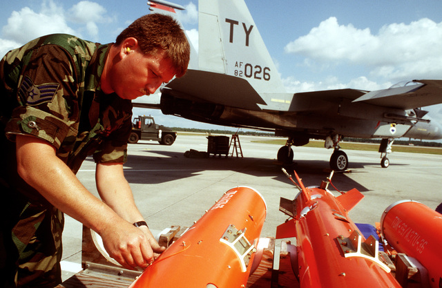 STAFF SGT. James Wilson straps AGTS-36 Aerial GUNNERY Target Sets to a weapons trailer on the flightline during competition William Tell '94. The AGTS-36 is towed behind a specially modified F-15 Fighter aircraft to provide the competing teams something at which to shoot their 20mm lead. ammunition at