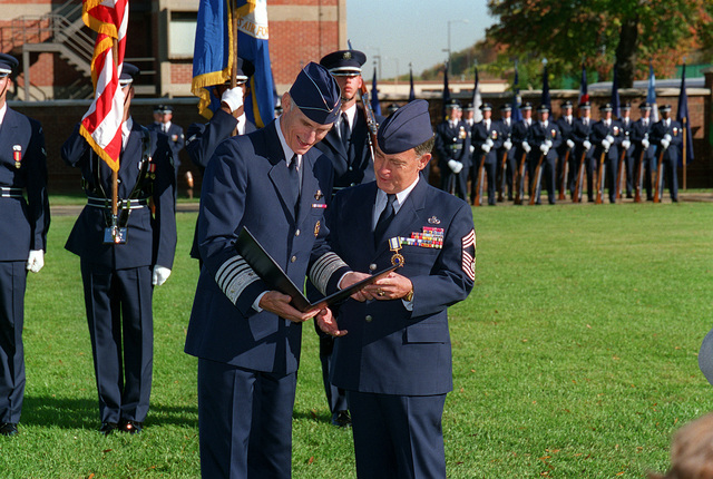 General Merrill A. McPeak, Air Force CHIEF of STAFF, and CHIEF MASTER SGT. of the Air Force, Gary Pfingston, read the citation for his distinguished service medal at his retirement