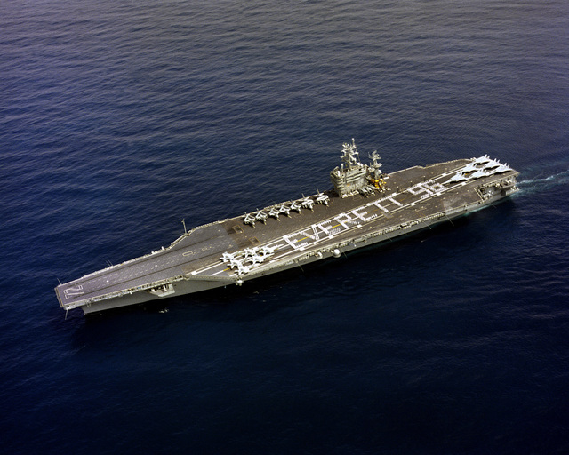 An aerial port quarter view of the nuclear-powered aircraft carrier USS ABRAHAM LINCOLN (CVN-72) approaching its future homeport. The LINCOLN is the first aircraft carrier to tie up at the new pier in Everett. The ship is scheduled to change homeport's from NAS Alameda, California to Everett in late 1996