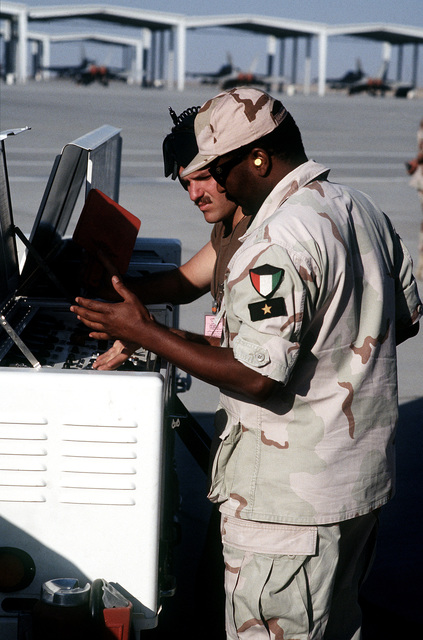 The Kuwaiti soldiers from Al Ahmed Jabar Air Base, work with the aircraft power cart