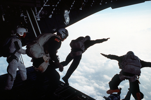 Combat Control team members perform the first High Altitude, Low Opening (HALO) jump from a C-17 Globemaster III from Charleston AFB. The jump was made over North Auxiliary Airfield in North, S.C. HALO jumps are normally made at 10,000 feet or higher, allowing the parachutists to free-fall and open their chutes at a low altitude, landing undetected in hostile environments. This maneuver also allows the aircraft to evade any potential ground attack. Exact Date Shot Unknown .Published in AIRMAN Magazine November 1994