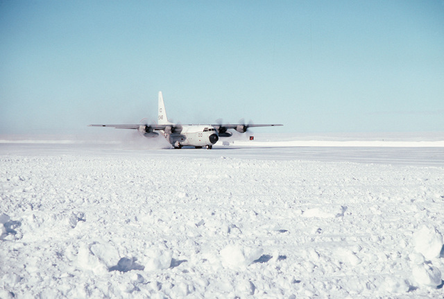 A C-130T Hercules aircraft of Antarctica Development Squadron Six (VXE-6) just after touching down at the airfield. The aircraft is carrying Vice Admiral Robert J. Spane, commander, Naval Air Force, US Pacific Fleet for an inspection tour of the facilities