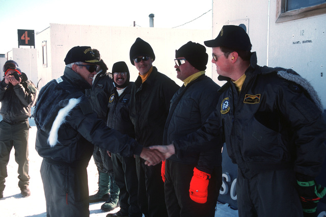 Vice Admiral Robert J. Spane, commander, Naval Air Force, US Pacific Fleet, expresses his thanks to the C-130 flight crew of Antarctica Development Squadron Six (VXE-6) that transported him to the site