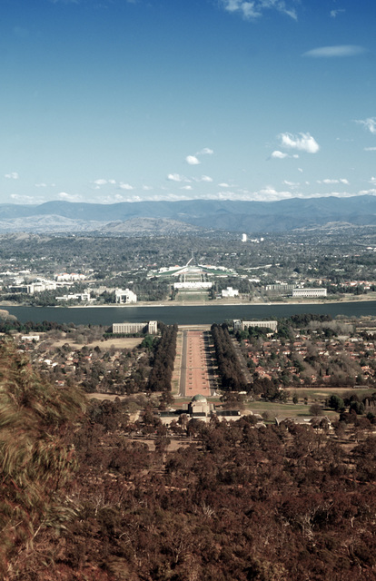 "A high angle view looking down from behind the Perth Observatory and across Lake Burley Griffin at the Lakeside Parliament House and adjacent national areas of Canberra, Australia. From AIRMAN Magazine's December 1994 issue article ""Foreign Exchange"""