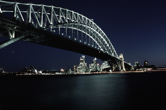 "A nighttime view of the Harbor Bridge, Opera House and Sydney, Australia skyline. From AIRMAN Magazine's December 1994 issue article ""The Wonder Down Under"""