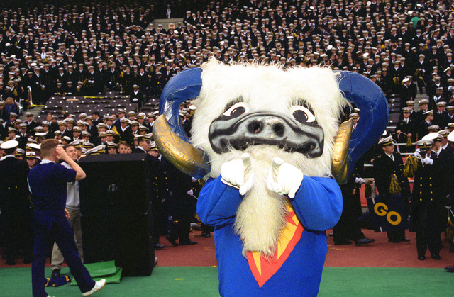 The Navy's mascot Ram is shown at the annual Army-Navy football game at Veteran's Stadium helping to lead the U.S. Navy Academy midshipmen in cheers to encourage Navy to win