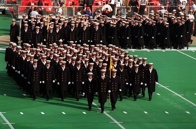 The U.S. Naval Academy Midshipmen march onto the field during the opening ceremony of the annual Army-Navy football game at Veteran's Stadium