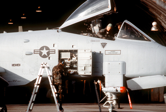 SSGT Michael Bolton assists LCOL Ruger Seidell in exiting his A-10 Thunderbolt while SSGT Michael B. Hoffman performs post flight checks on the aircraft. LCOL Seidell is deployed from the 172nd Fighter Squadron, SSGT Bolton and Hoffman are from the 110th Fighter Group. The 110th Fighter Group is deployed to Aviano to relieve the 81st Fighter Squadron of Spangdahlem Air Base, Germany, in time for the Christmas holidays. The 81st and the 110th are deployed to Aviano to enforce the United Nations no-fly zone over war-torn Bosnia-Herzegovina