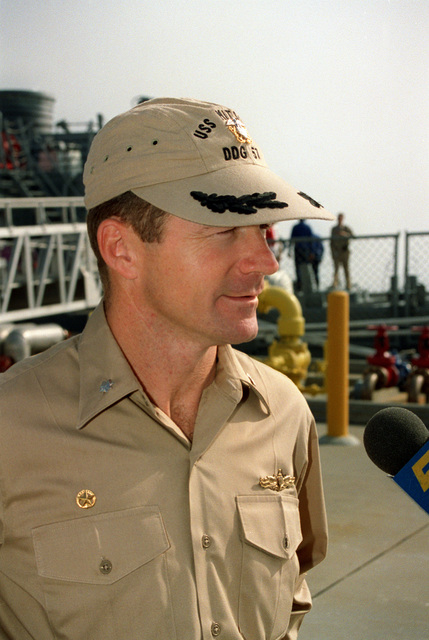 Commander Roy Joseph Balaconis, commanding officer of the guided missile destroyer USS MITSCHER (DDG-57), speaks with members of the press during a precommissioning briefing. The ship will be commissioned on December 10th. The Commander is wearing a Khaki ball cap like the one worn by the ship's namesake, Admiral Marc Mitscher, during World War Two. The MITSCHER is the only ship in the Navy authorized to use this as their official headware